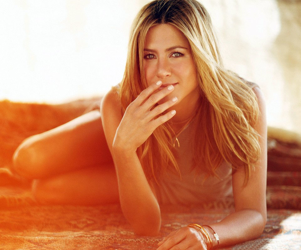 jennifer-aniston-laying-on-a-plaid