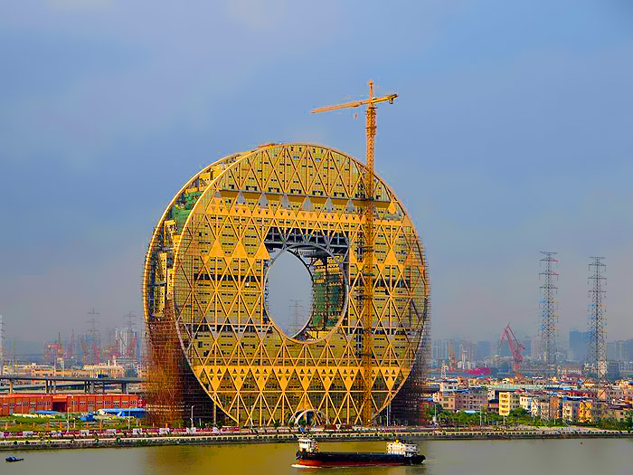 theyve-almost-finished-construction-on-this-awesome-building-that-looks-like-a-giant-coin_hiiky_0